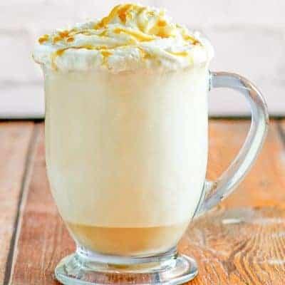 caramel cappuccino in a glass mug