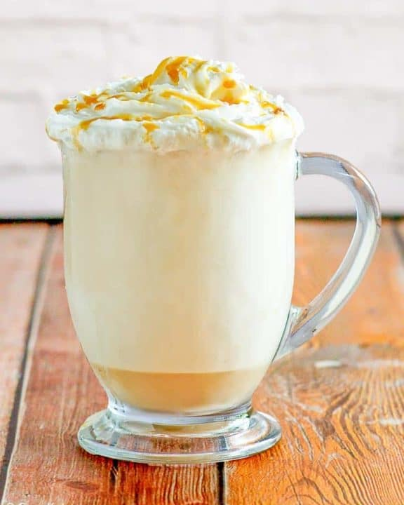 caramel cappuccino in a glass mug