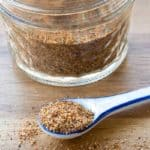 Red Lobster Cajun Spice Seasoning Mix in a measuring spoon and glass jar