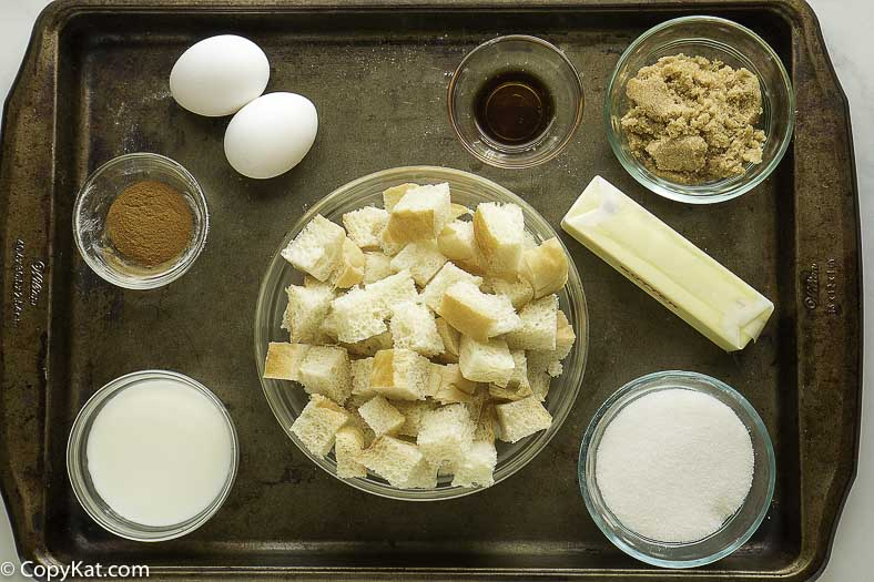 bread, sugar, butter, and more to make bread pudding