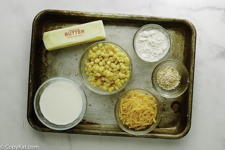 corn, cream, butter, onions, and cheese to make creamed corn