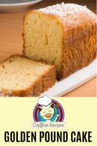 golden pound cake on a white platter