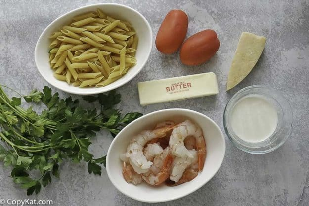 penne pasta, medium sized shrimp, Parmesan cheese, tomatoes and more