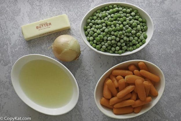 carrots, peas, butter, chicken stock, and onion for peas and carrots