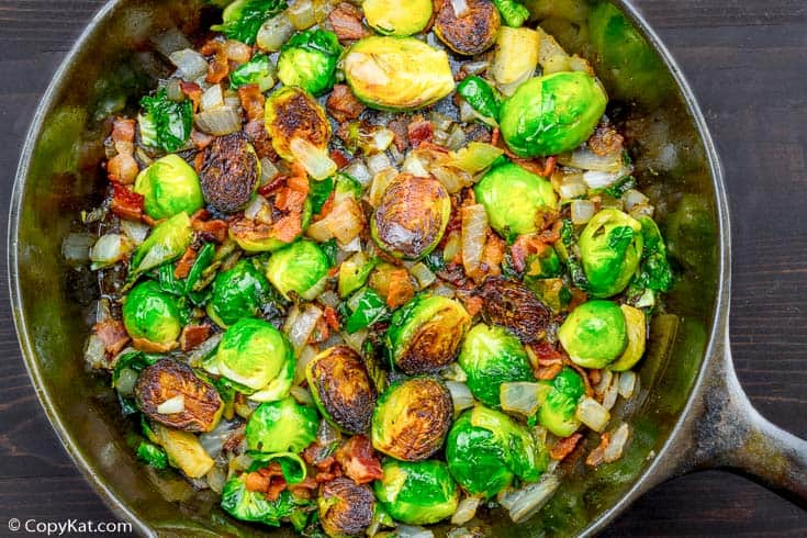 roasted brussels sprouts with bacon and onion in a cast iron skillet