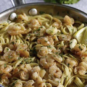 a skillet of garlic shrimp pasta