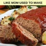 meatloaf with sauce served with roasted potatoes