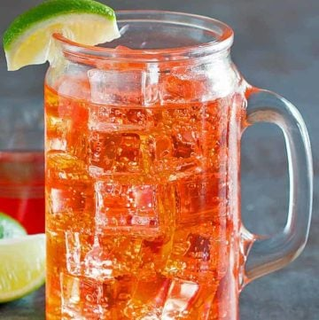 cherry limeade in a glass with a handle