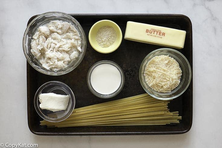 crab, pasta, and alfredo sauce ingredients
