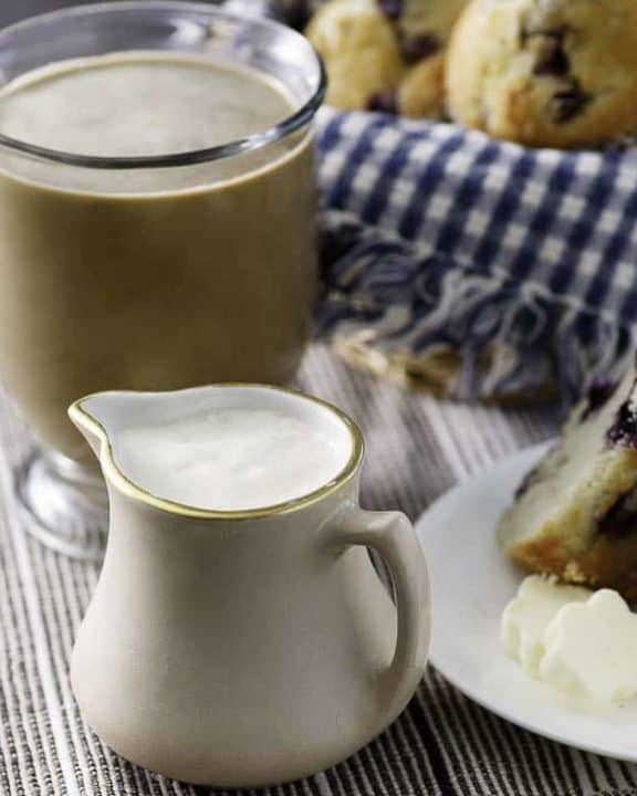 french vanilla coffee creamer with a cup of coffee and blueberry muffins