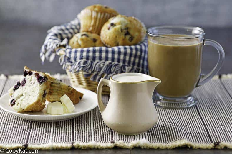 blueberry muffins, a cup of coffee and homemade french vanilla creamer