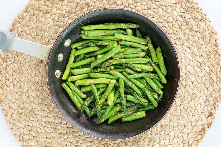 chopped asparagus in a skillet