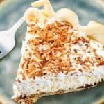 a slice of Bakers Square coconut cream pie on a blue plate