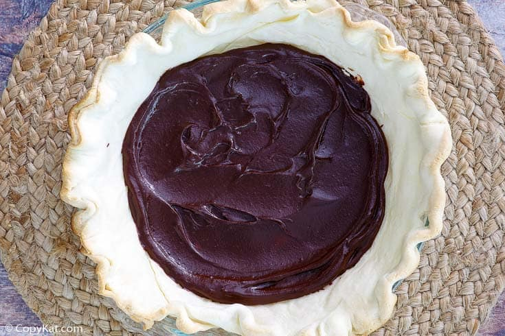coconut cream pie crust with chocolate layer in it