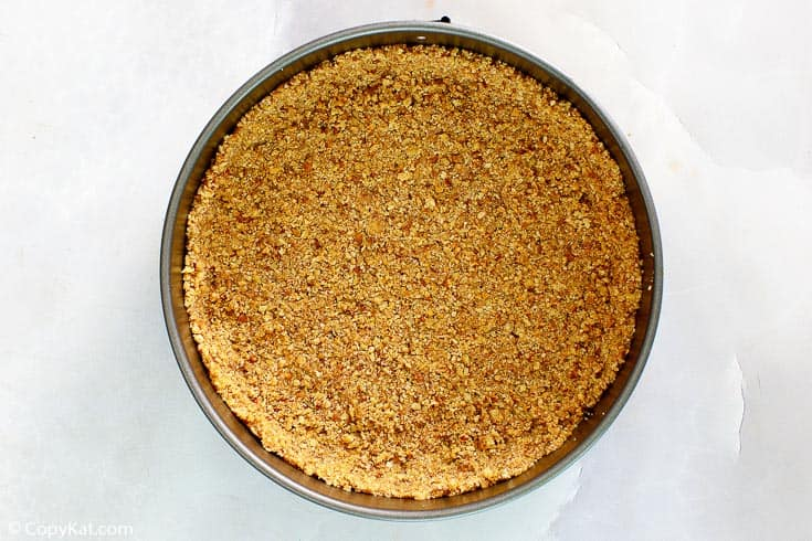 nut crust for cheesecake in a springform pan