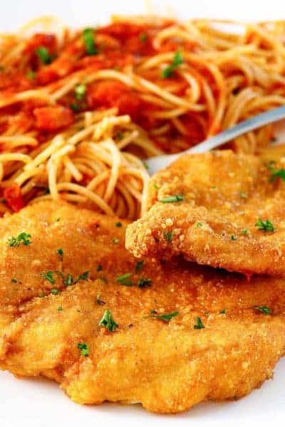Romano crusted chicken and pasta with marinara sauce