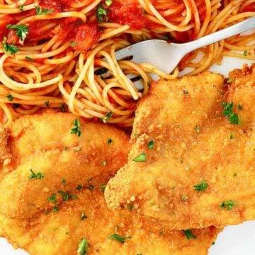 Romano cheese crusted chicken and pasta with marinara