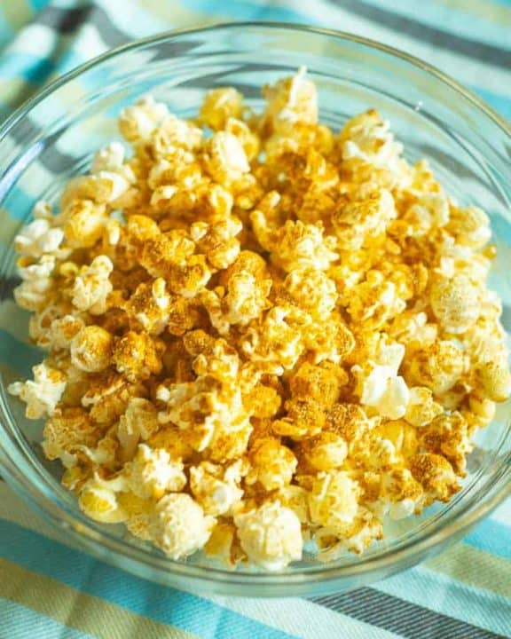 curry popcorn in a glass bowl