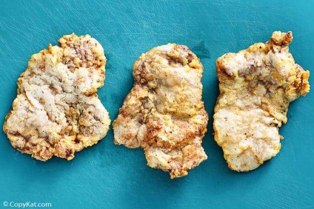 three chicken fried steaks