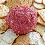 Dried beef cheese ball and crackers on a platter