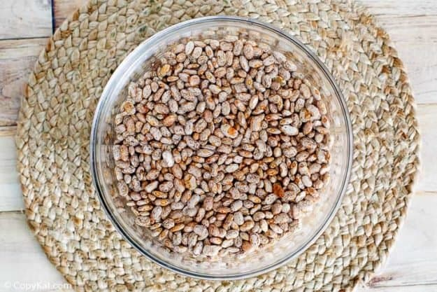 dried pinto beans in a glass bowl