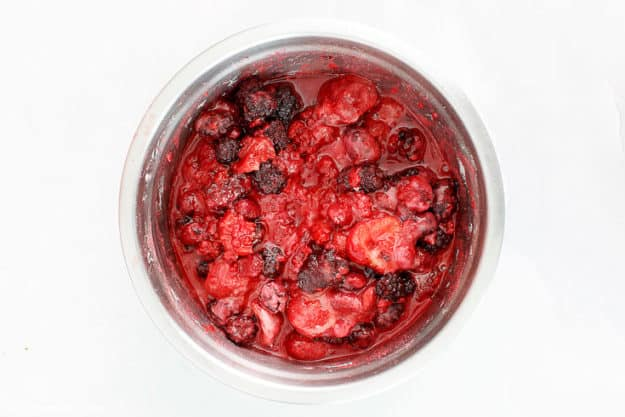 fruit of the forest pie filling mix in a bowl