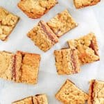 fudge jumbles cookie bars scattered on top of parchment paper