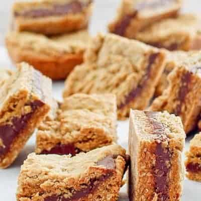 several fudge jumbles cookie bars on top of parchment paper