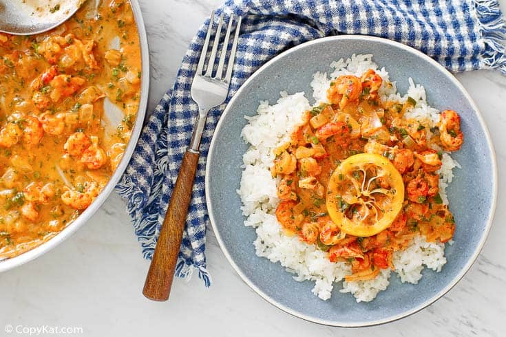 crawfish etouffee over white rice and in a pan