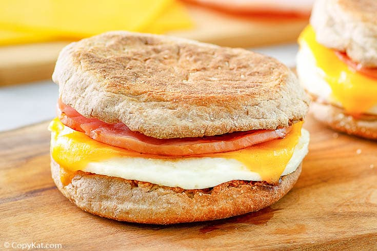 an egg white breakfast sandwich with Canadian bacon and cheese