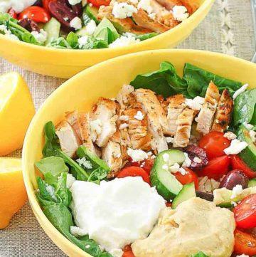 two Mediterranean grain bowls with chicken