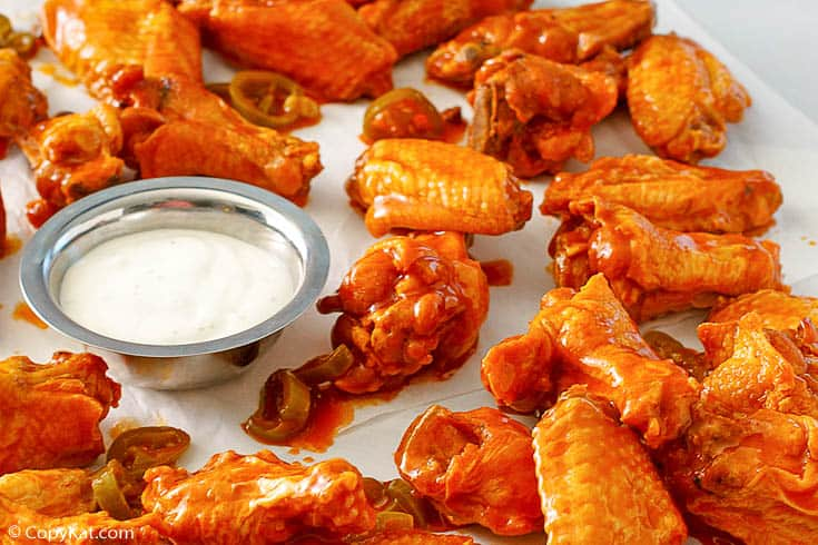 homemade jalapeno Buffalo chicken wings and blue cheese dressing