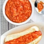 homemade sabrett onion sauce in a bowl and on a hot dog