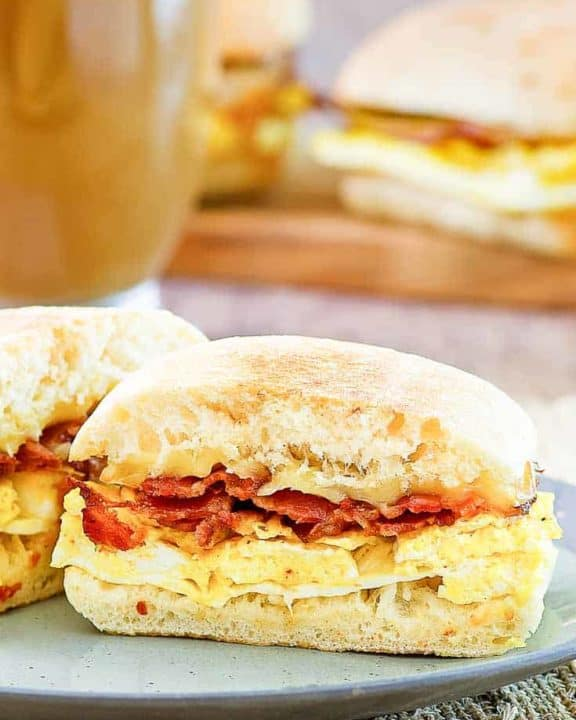 breakfast sandwich with bacon, egg, and gouda cheese