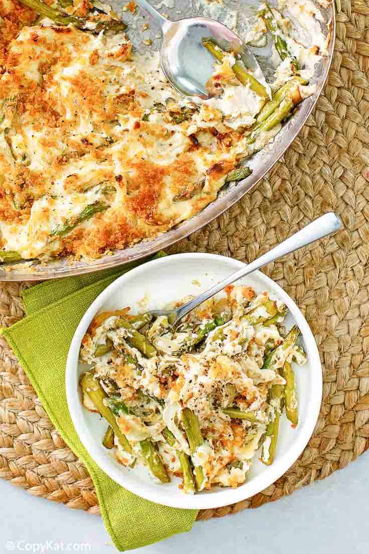 Swiss asparagus casserole in a skillet and a bowl