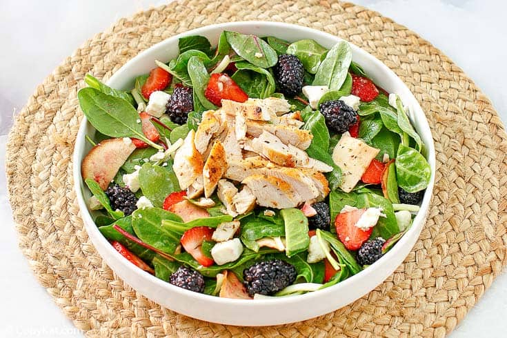 a bowl of berry chicken salad with feta cheese