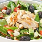 salad with grilled chicken, lettuce, berries, and feta cheese