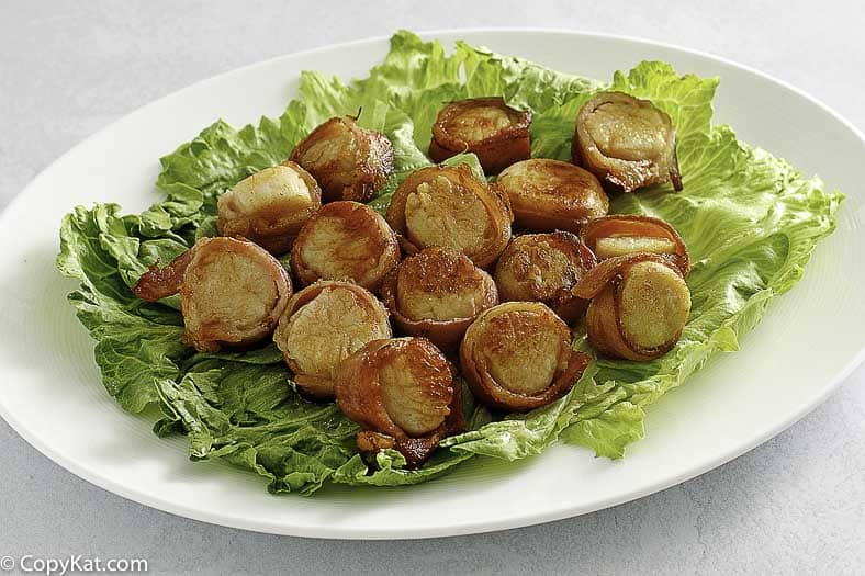 a platter of bacon wrapped scallops