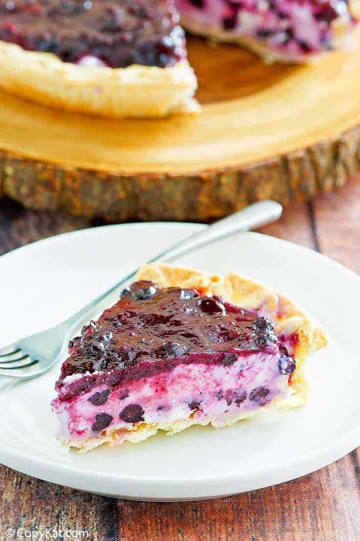 a slice of blueberry cream cheese pie on a white plate