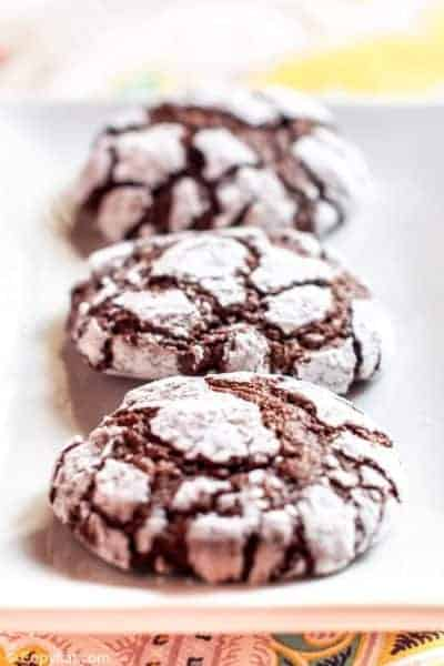 chocolate crinkle cookies on a white plate