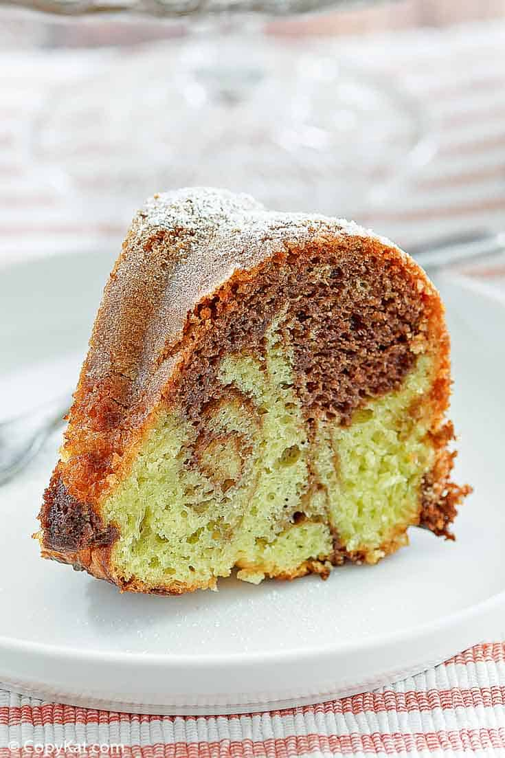 a slice of chocolate pistachio bundt cake