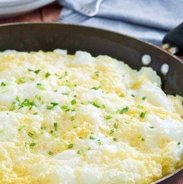 fluffy omelette in a non-stick skillet