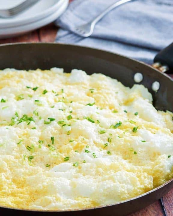 fluffy omelette in a non-stick skillet