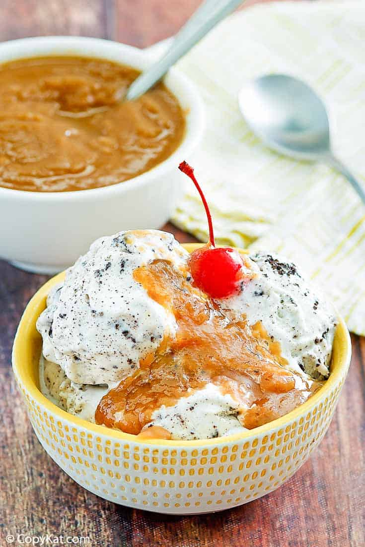 peanut butter sauce on top of ice cream in a bowl