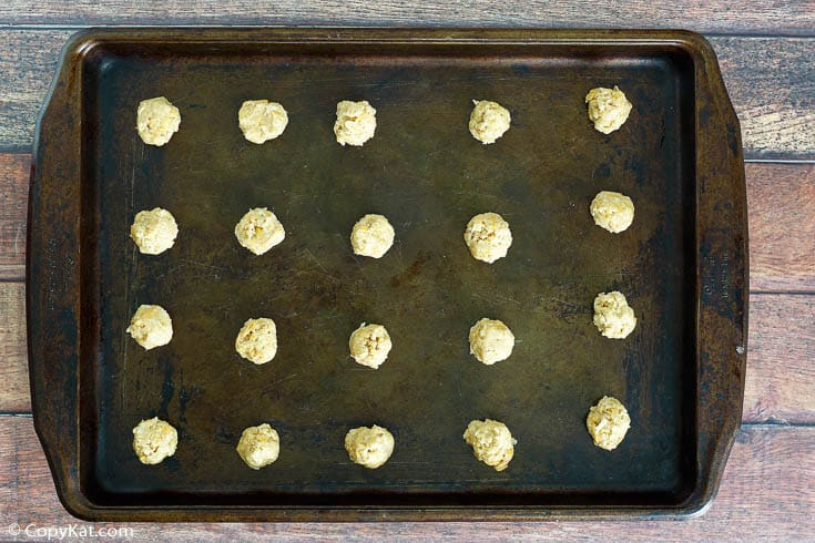 oatmeal coconut crunchies cookie dough balls on a baking sheet