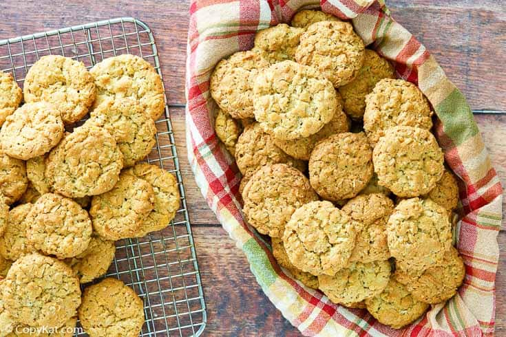 oatmeal coconut crunchies cookies in a basket and on a wire rack