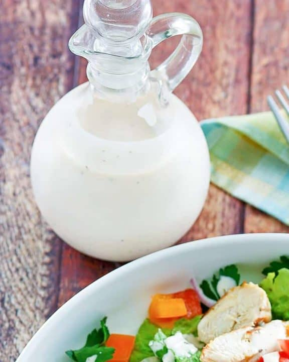 a bottle of homemade Old Spaghetti Factory creamy pesto dressing