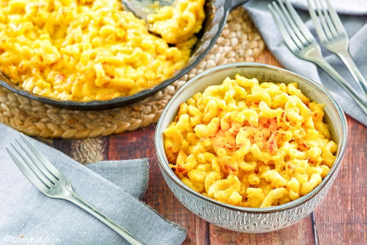 homemade Stouffers Mac and Cheese in a blue bowl and baking dish