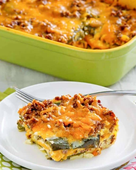 a serving of chili relleno casserole with beef in front of the casserole