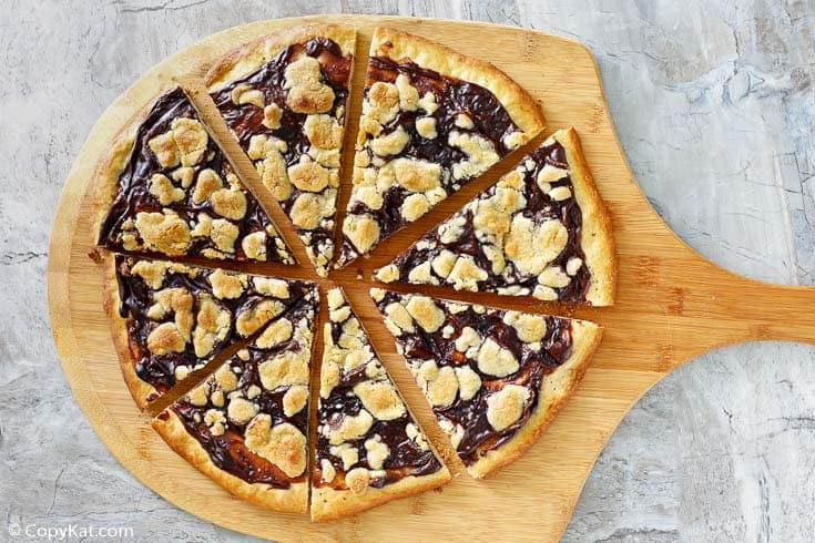 sliced chocolate dessert pizza on a pizza peel